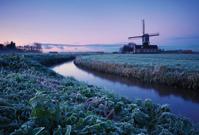 Winter landscape with a windmill