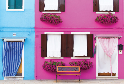 Pink and blue house facades