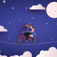 Couple on a bicycle at night