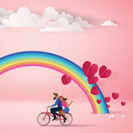 Couple on a bicycle and the rainbow